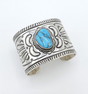 Navajo artist Jack Adakai wide, large stamped cuff set with lovely turquoise stone.