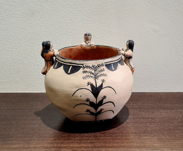 Storyteller handcoiled clay pot by potter Seferina Ortiz, Cochiti, New Mexico