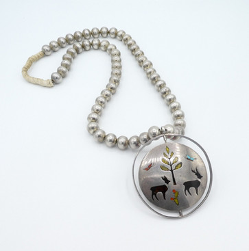 Vintage Zuni spinner pendant with amazing silver beads