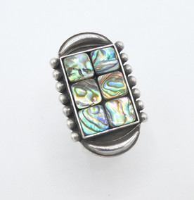 Contemporary abalone and silver ring by Mike Bird Romero.