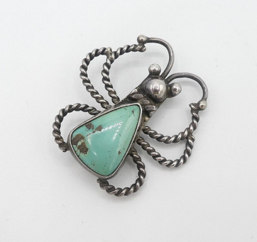 Contemporary bug pin and or pendant with green turquoise.