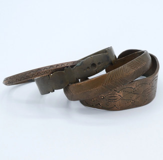 Turn of the century selection of Pueblo copper stamped cuffs.