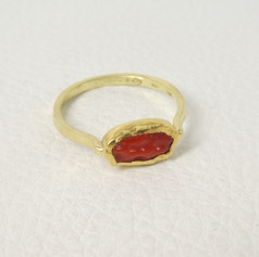 R16. Coral with 22ct bezel with 18ct shank ring