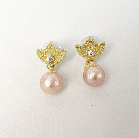 E17. 18ct Gold tulip earrings, faceted fresh water pearls with diamonds.