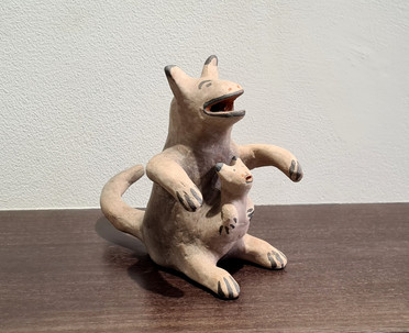 Early clay kangaroo with baby figure from Cochity