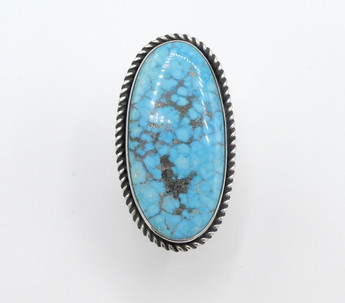Contemporary Navajo large spiderweb turquoise and silver ring with twist wire detail.