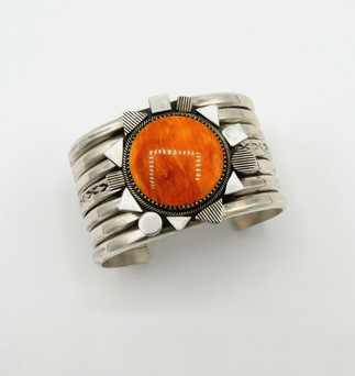Mike Bird Romero  orange spiny oyster shell and silver wide cuff