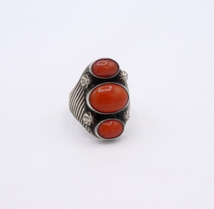 Vintage Navajo silver ring set with three domed round coral stones.