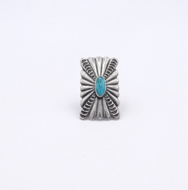 Vintage Navajo stamped shield ring with central turquoise stone.