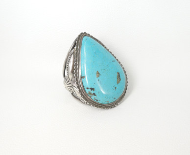 Vintage Navajo cuff with a singular very large turquoise stone set in amazing silver setting