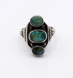 Petite vintage Navajo ring set with three green turquoise stones.