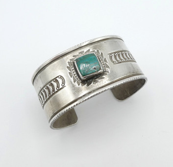 Greg Lewis wide silver stamped cuff with central turquoise stone