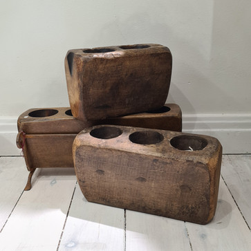 Vintage Southwestern carved wooden sugar molds with iron stands
