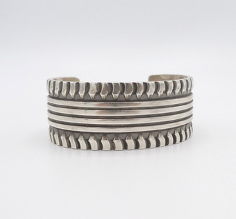 Silver linear and stamped cuff by contemporary artist, Elvira Bill.