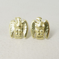 E3. Golden eagle posts 18ct.