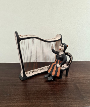 'The Harp Player' sculpture by potter Seferina Ortiz.