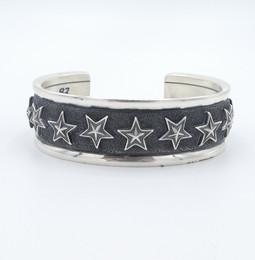 Navajo artist Cody Sanderson - oxidised silver star cuff.