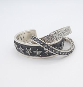 Wonderful handmade star cuffs by Navajo artist, Cody Sanderson.
