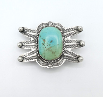 Amazing vintage Navajo buckle with stamping and large high set turquoise stone.