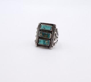Vintage Navajo ring with three turquoise rectangular cut stones.