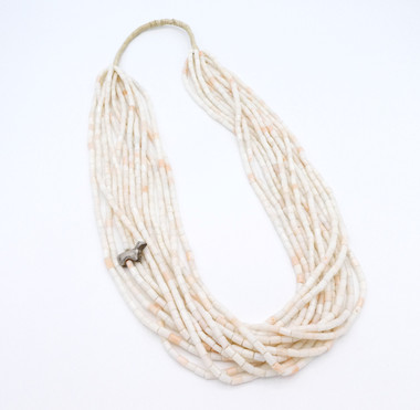 Thirteen strand shell heishi necklace with one silver bear fetish and squaw wrapping.