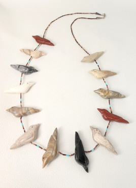 Contemporary carved bird fetish necklace strung on fine heishi