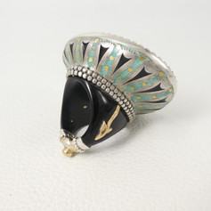 R1. Underside of Buffalo ring showing enamel and gold detail with diamond