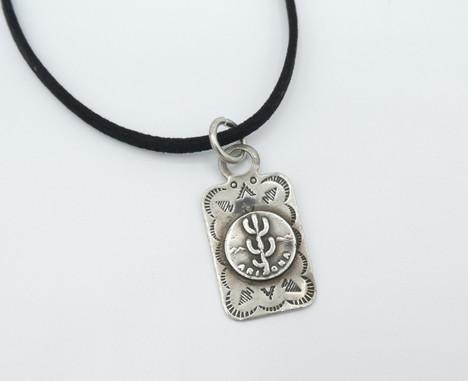 Vintage Navajo silver stamped pendant with cactus design