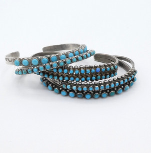 A great collection of vintage Zuni blue turquoise petit-point row cuffs.