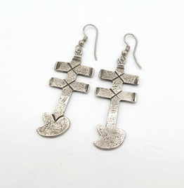 Silver cross earrings by artist Greg Lewis