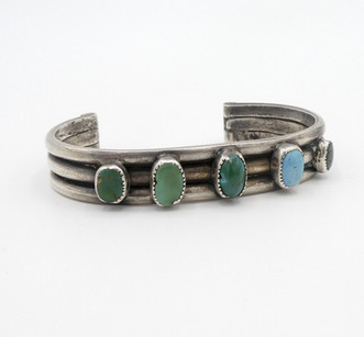 Old pawn Navajo ribbed cuff with five central turquoise stones.