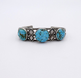 Unusual vintage Navajo cuff set with three round domed very blue turqouise stones.