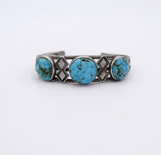 Unusual vintage Navajo cuff set with  #8 domed Turquoise