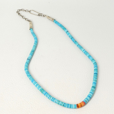 Fine turquoise heishi with orange spiny oyster shell tabs by Piki Wadsworth.