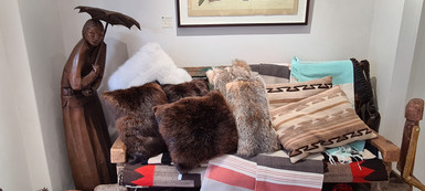 A selection of plush fur cushions