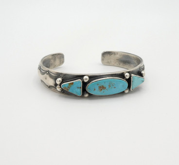 Great turquise and silver stamped cuff set with three turquoise stones by Fritson Toledo