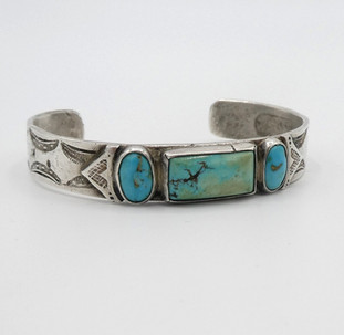 Old pawn Navajo silver stamped cuff with three set turqouise stones.