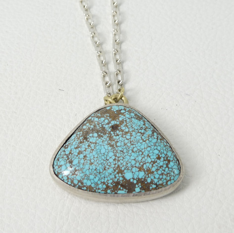 N14. Spider Web Turquoise, 18ct horse and sterling on reverse.