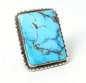 Amazing large rectangular cut turquoise stone set in silver Navajo ring