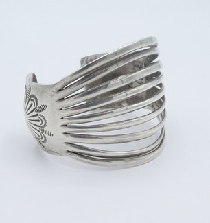 1950's  striated wide silver cuff with repousse detail.