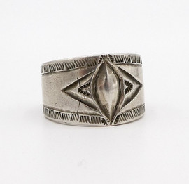 Navajo stamped silver band with central diamond repousse