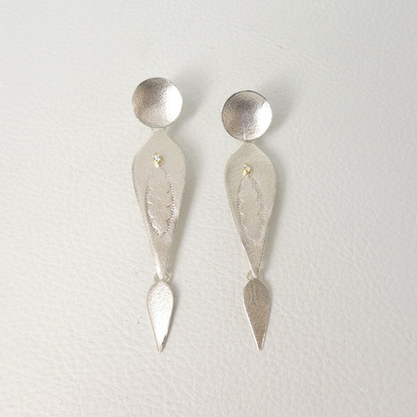 E24. Feather shaped drop sterling earrings, 18ct with diamonds.