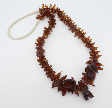 Fabulous vintage Zuni amber carved fetish necklace with squaw wrapping.