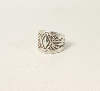 Stamped silver Navajo band by artist Thomas Curtis