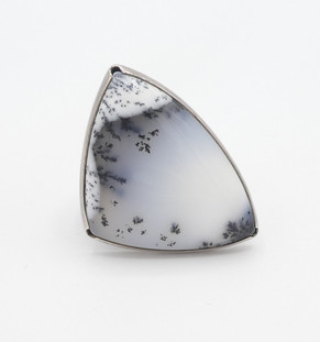 Isaiah Ortiz  large dendritic agate set in silver stamped setting.