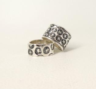 Two silver star bands by Navajo designer Cody Sanderson