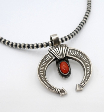 Naja silver pendant with natural coral by Calvin Martinez.