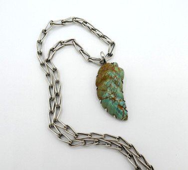 Turquoise carved leaf pendant set in silver and strung on silver chain