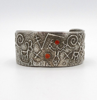 Navajo artist Stewart Billie wide silver figurative sandcast cuff with coral