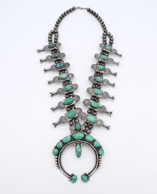 Wilson Jim green turquoise and silver squash blossom necklace.